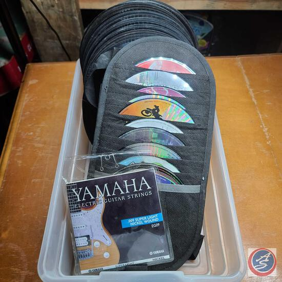 Playstation games in case, loose 45 records, and Yamaha guitar strings