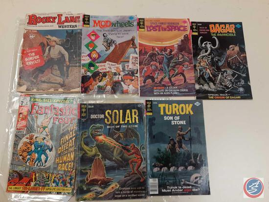 Comic Books in Plastic Including: War is Hell, Lost in Space, Rocky Lane Western (1949) (Volume 2),