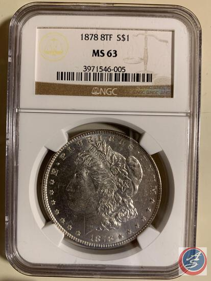 Silver Dollar 1878 NCG slabbed and graded MS 63