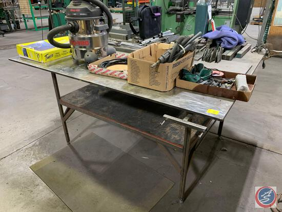 Welding bench with 60 x 72 x 1/2 inch top.Contents not included.