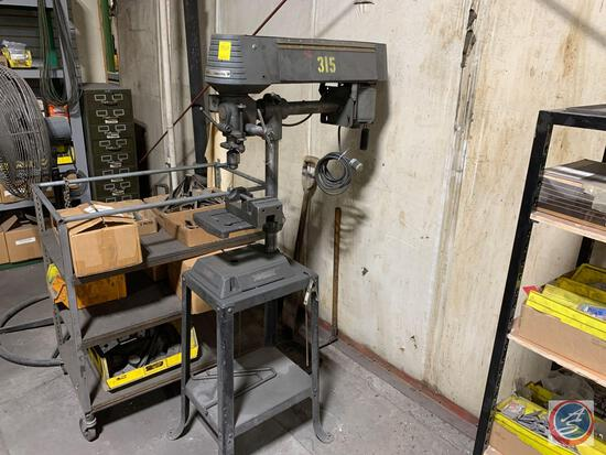 Rockwell Model 11-280 bench top drill press on stand.