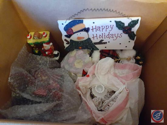 Assorted Holiday Decorations Including Santa's Sleigh, Small Nativity Scene, Santa and Mrs. Claus