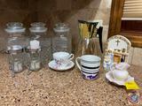 (3) Cookie Canisters with Lids, Gold Leaf Coffee Pot, (2) Butter Dish Warmers and Cup and Saucer by