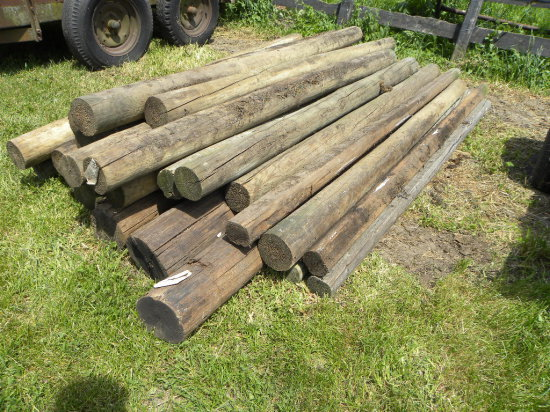 PILE OF APPROXIMATELY 25 CEDAR POSTS