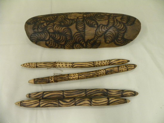 4 ABORIGINAL CLAPPING STICKS & A CARVED WOODEN SHIELD