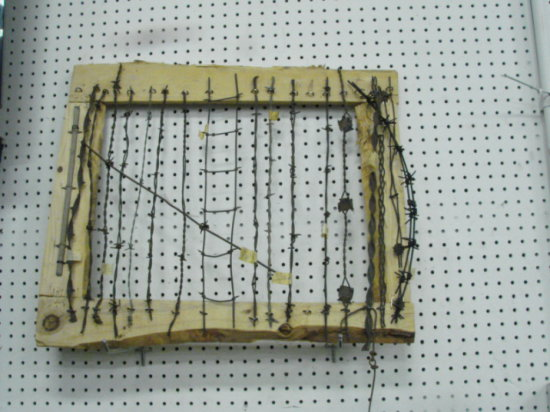 FRAMED SAMPLE OF VINTAGE / ANTIQUE BARBED WARE
