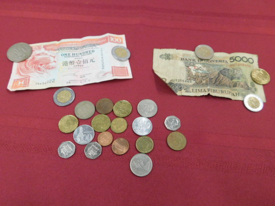 SMALL BAG OF FOREIGN COINS AND BILLS