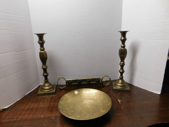 brass candle sticks and a brass bowl