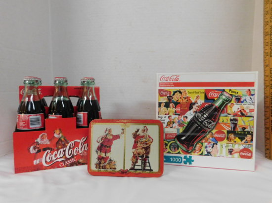 6 PACK OF 1998 CHRISTMAS COKE, TIN OF PLAYING CARDS & A PUZZLE