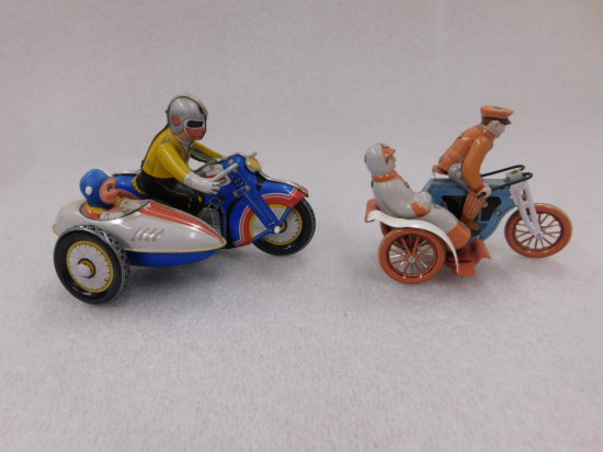 (2) TIN WIND UP MOTORCYCLES W/ SIDE CARS