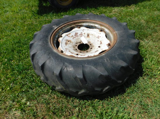 14.9X28 TRACTOR TIRE ON 8 LUG RIM