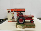 SPEC CAST 1/16 FARMALL 560 RESIN TRACTOR ON SCULTURED BASE W/ BOX