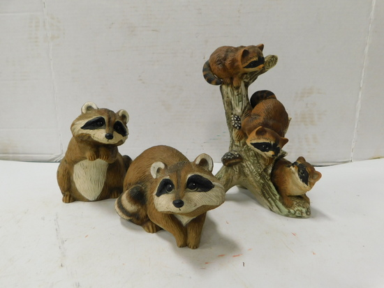 PLASTIC AND PORCELAIN RACCOON FIGURINES