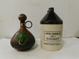 STONE WARE WHISKEY JUG AND LEATHER COVERED GLASS JUG