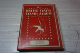 1938 UNITED STATES STAMP ALBUM W/ SOME STAMPS