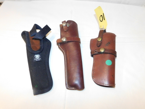 (3) PISTOL HOLSTERS - 2 LEATHER & 1 CANVAS