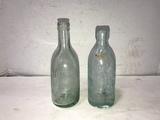 (2) ANTIQUE SODA BOTTLES