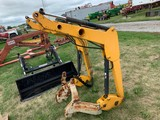 YELLOW HYDRAULIC LOADER FOR A COMPACT TRACTOR