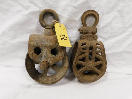PAIR OF IRON BARN PULLEYS