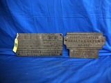 PAIR OF CAST IRON NAME PLATES