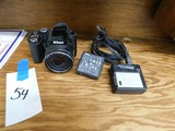 NIKON COOL PIX P90 DIGITAL CAMERA W/ CHARGER & (2) BATTERIES