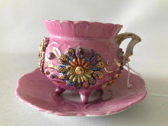 German Pink Lustreware Footed Cup & Saucer W/Embossed Floral Decoration