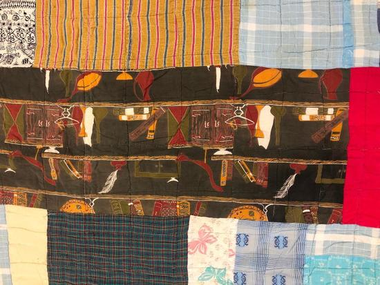 Vintage Wacky Free Form Patchwork Quilt With A Satin Edging.