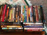 (36) DVD's In Cases