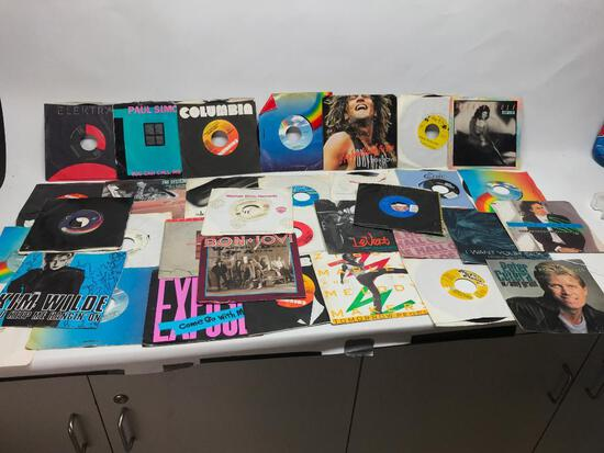 You are getting what is pictured in the lot. It appears to have various genres! The records are also