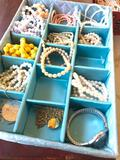 Group Of Costume Jewelry Bracelets In Holder