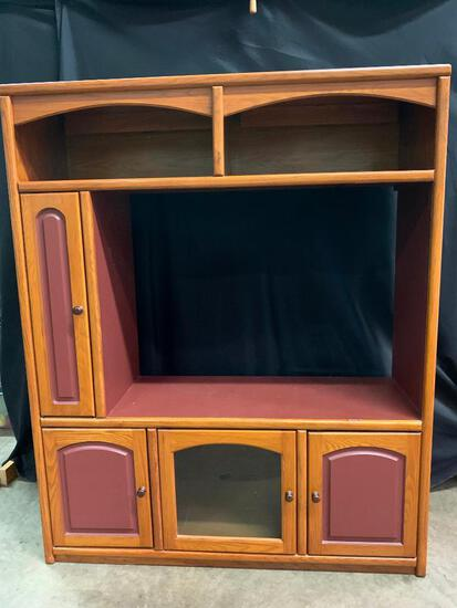 Very Large Oak Entertainment Center with a Maroon Color Accent