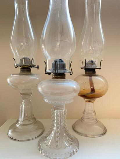 Three Antique Oil Lamps with Glass Chimneys