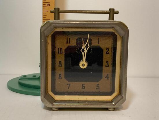 """Vintage Windup Metal Clock. This Item is 4.75"""" Tall"""