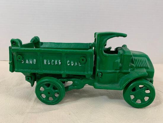 """Reproduction Cast Iron Dump Truck. This Item is Approx 8.5"""" Long x 4"""" Tall"""