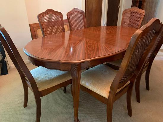 """Solid Wood Dining Table w/6 Cane Back Chairs. The Table is 29"""" Tall x 70"""" Long x 42"""" Wide"""