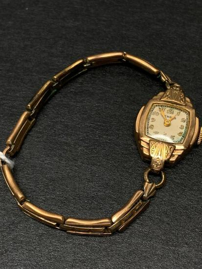 10 KT Gold Cased Benrus Ladies Wristwatch. The Band is Gold Filled - As Pictured