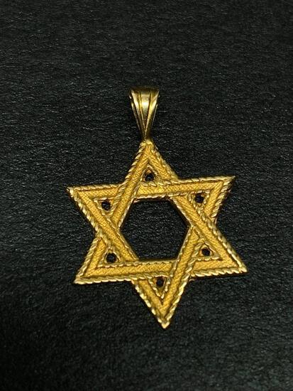 14 KT Gold Jewish Star Charm. The Weight is 1.4 Grams - As Pictured
