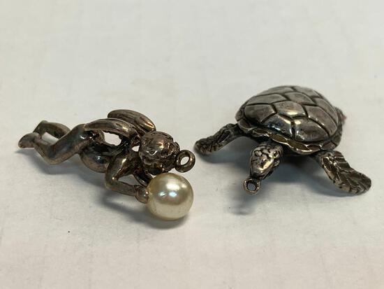 Pair of Sterling Silver Pendants. WT = 13.7 grams