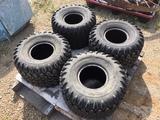 Four (4) 25x13.9 tires
