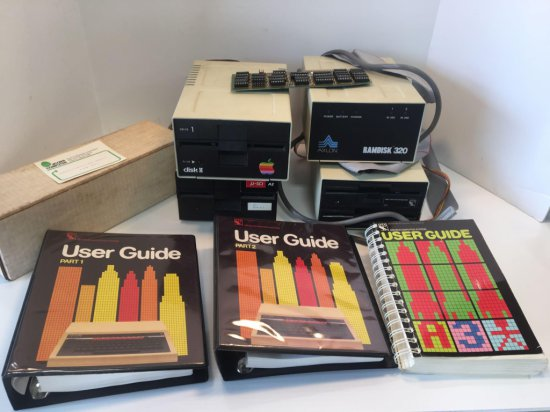 Vintage computer lot (APPLE external disk drive, user manuals,more)
