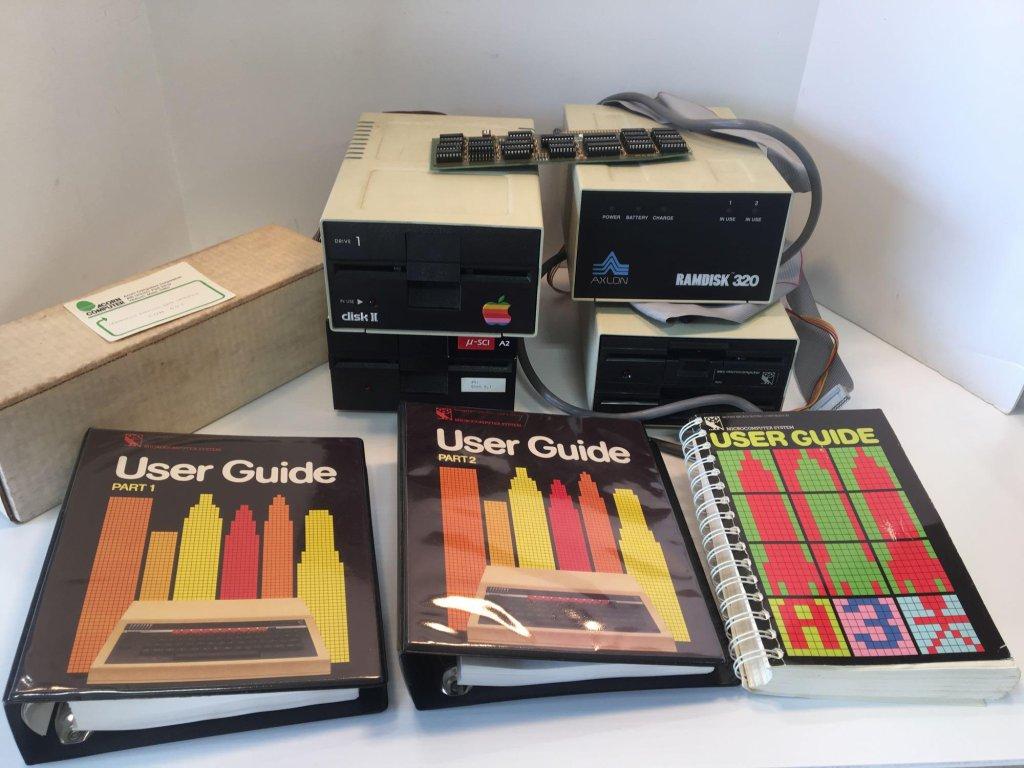 Vintage computer lot (APPLE external disk drive, user manuals,more)