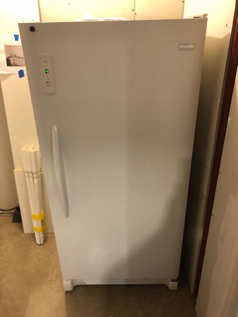 FRIDGADAIRE upright freezer(model LFFU14F5HWS)(contents not included)