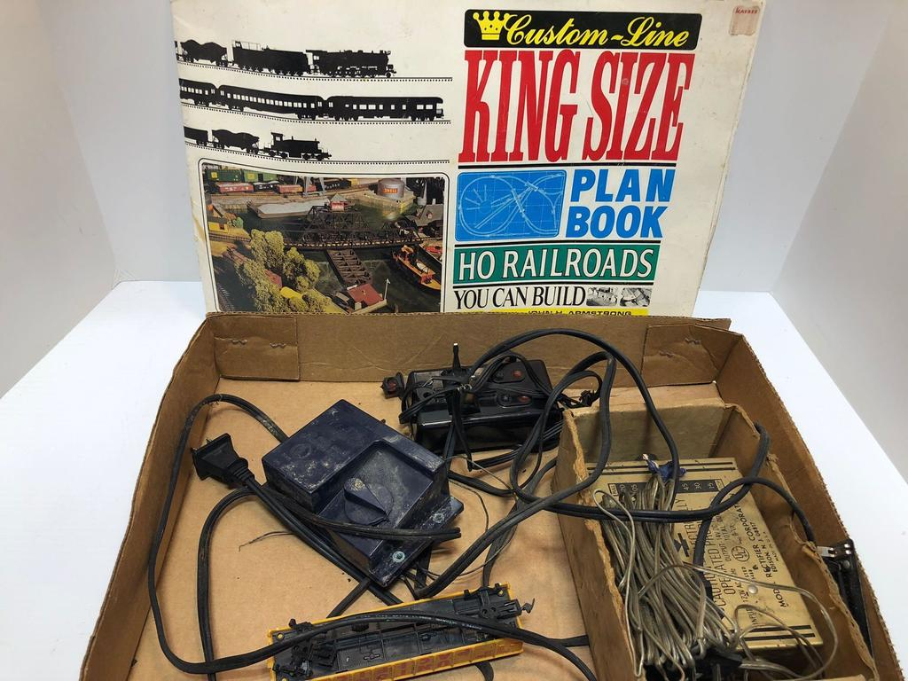 Lot: Train transformers,train set up book | Proxibid Auctions