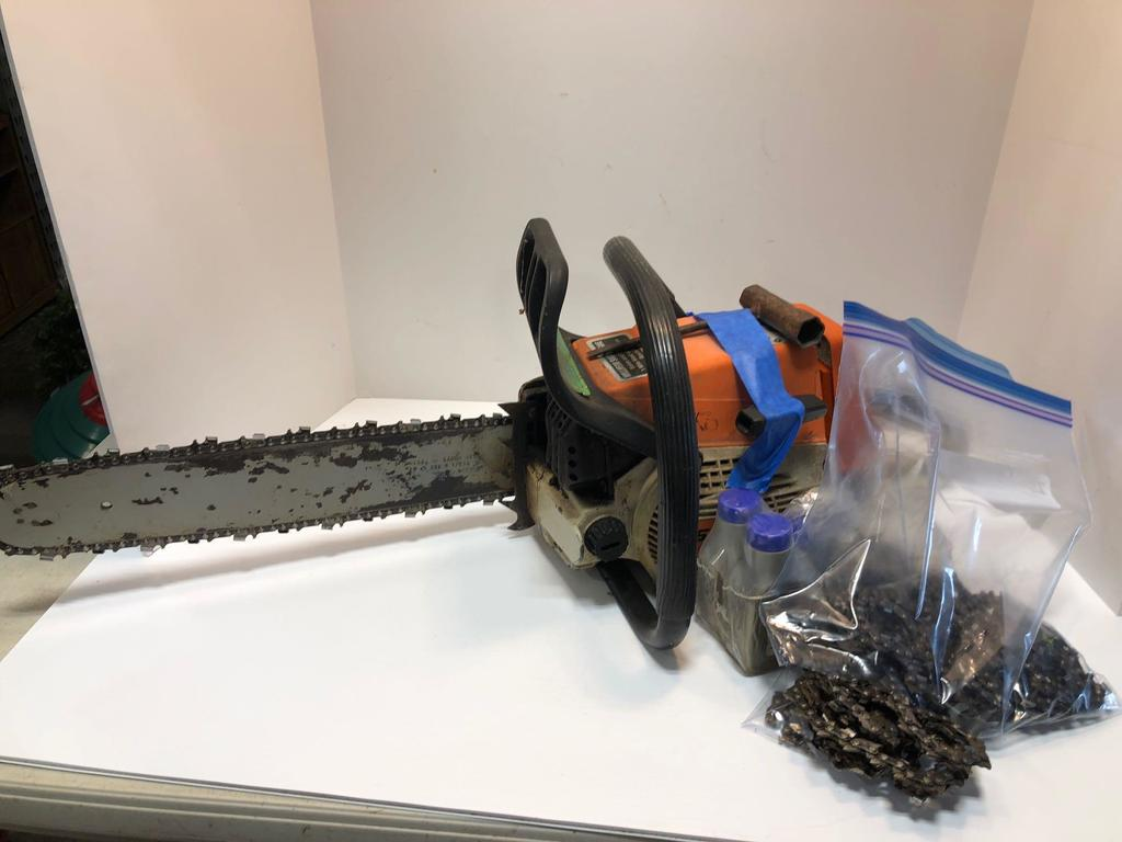 Lot: STIHL chainsaw/xtra chains and oil mix | Proxibid Auctions