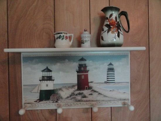 HAT COAT RACK WITH LIGHTHOUSE SCENE AND THREE SMALL COLLECTIBLE PIECES
