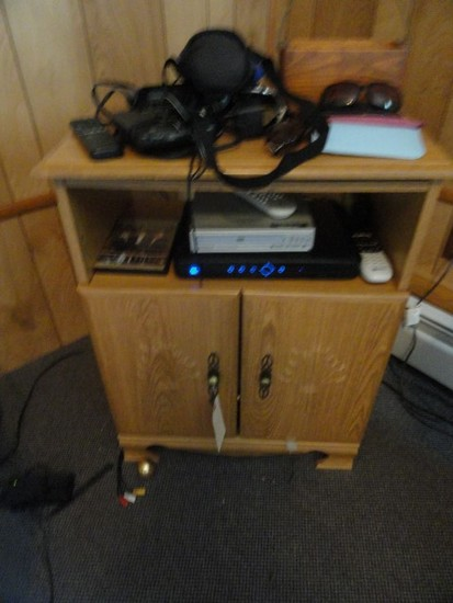 SMALL ENTERTAINMENT CENTER AND CONTENTS INCLUDING DVD PLAYER AND MORE
