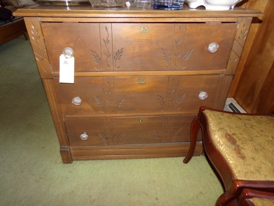 THREE DRAWER BUREAU WITH BRASS KEY HOLE GLASS PULLS AND CARVED DRAWERS