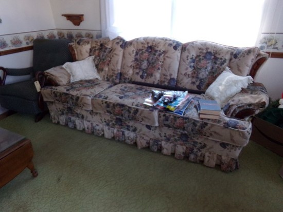 UPHOLSTERED FLORAL MOTIFF SOFA WITH A GOOSE NECK ROCKER