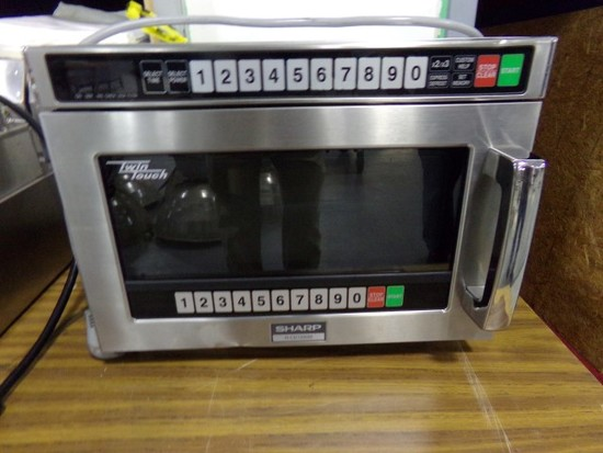 NEW SHARP TWIN TOUCH MICROWAVE 1200 WATT FULL WARRANTY SCRATCH AND DENT