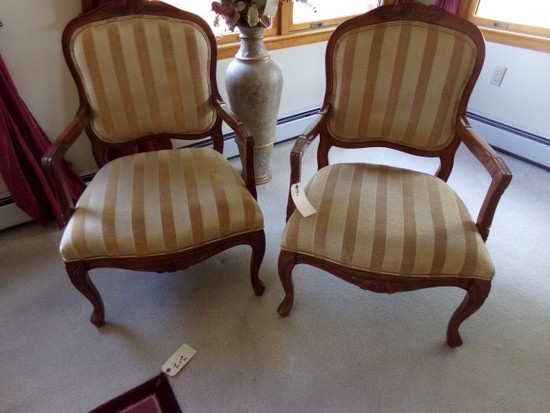 PAIR OF ARM CHAIRS UPHOLSTERED WITH MAHOGANY CARVED WOOD ARMS AND LEGS